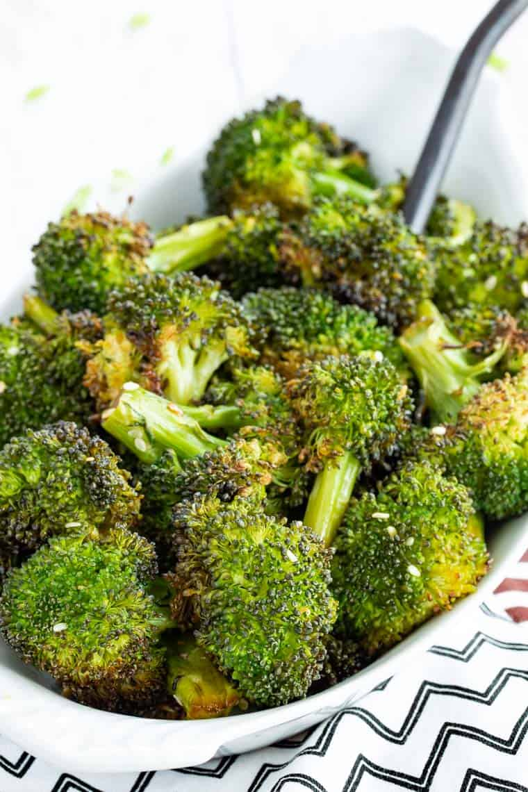 A white oval serving dish with Maple Sesame Broccoli