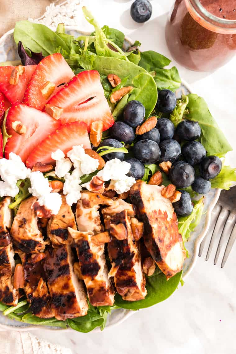 Overhead of Grilled Chicken Salad with berries and goat cheese