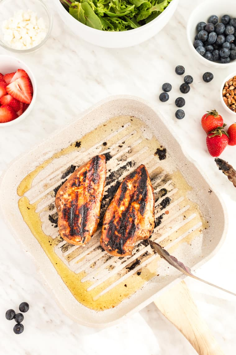 Blueberry Balsamic Marinated Grilled Chicken in a grill pan