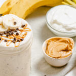 Chocolate Chip Banana Peanut Butter Banana Smoothie with ingredients in the background