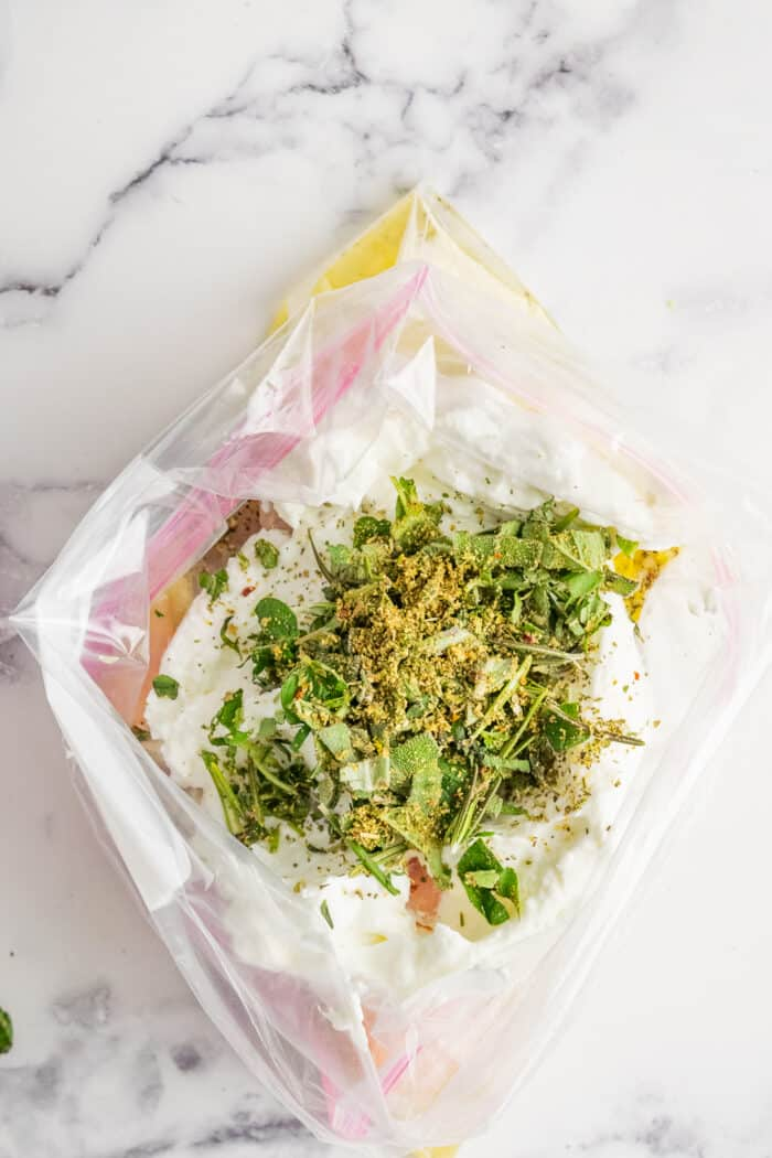 Herbs, yogurt and other ingredients in a plastic zipper bag