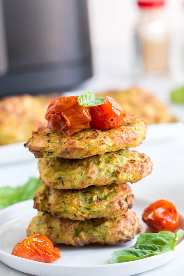 Stack of four Gluten Free Zucchini Fritters with roasted tomatoes