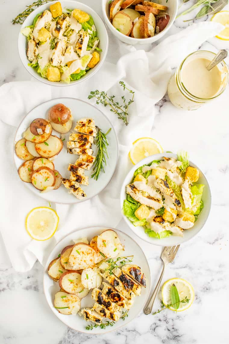 Lemon Herb Chicken served with various meals including with potatoes and Chicken Caesar Salad
