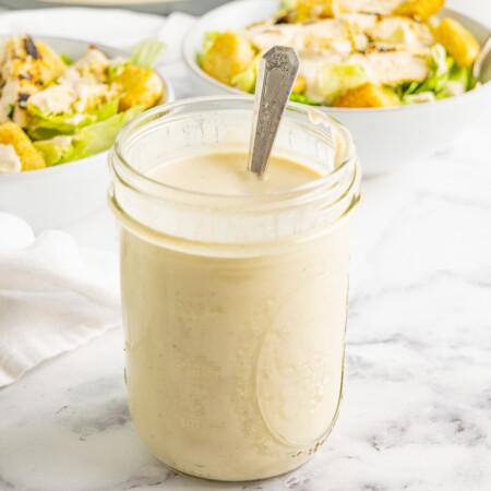 A mason jar of Greek yogurt Caesar salad dressing
