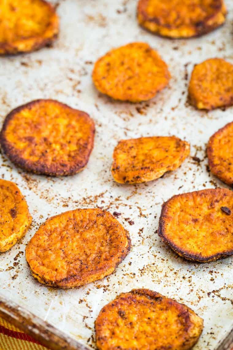 Chili Lime Roasted Sweet Potato Slices on a baking sheet