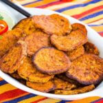 Chili Lime Roasted Sweet Potatoes in an oval white serving dish