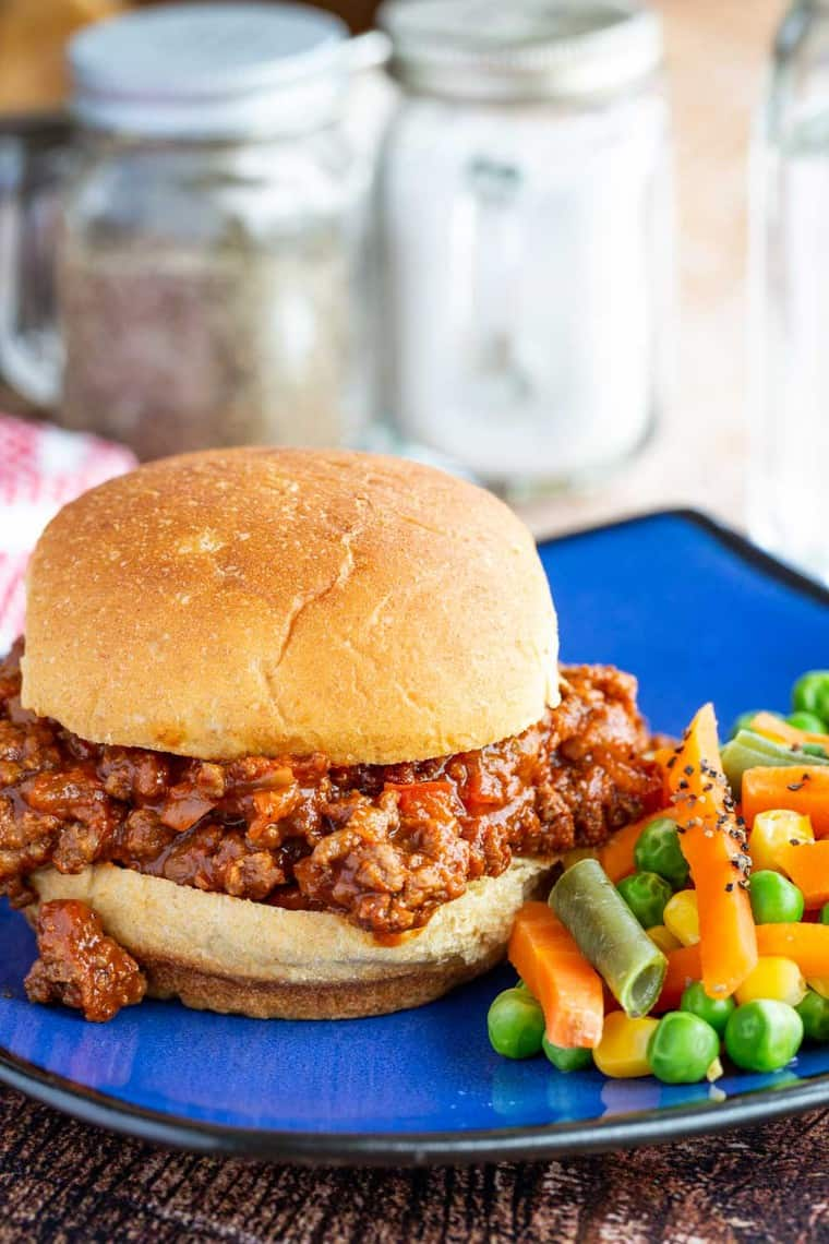 Homemade Sloppy Joes on a bun served with mixed vegetables