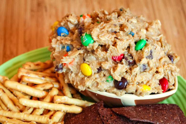 Edible Peanut Butter M&M Cookie Dough in a bowl shaped like a football