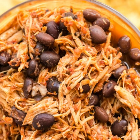 Slow Cooker Salsa Chicken and Black Beans in a glass bowl