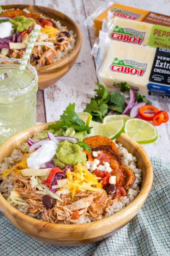 Slow Cooker Chicken Burrito Bowls with blocks of Cabot cheese
