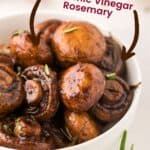 Roasted Mushrooms with text that shows they contain Garlic Balsamic vinegar and Rosemary