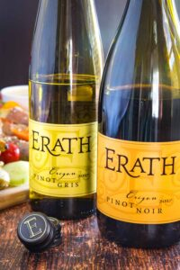 Bottles of Erath Pinot Noir and Pinot Gris with bottle caps