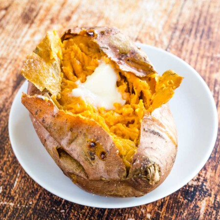 Baked Sweet Potato with butter on a plate