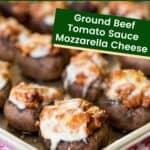 Mozzarella and Ground Beef Stuffed Mushrooms on a baking sheet