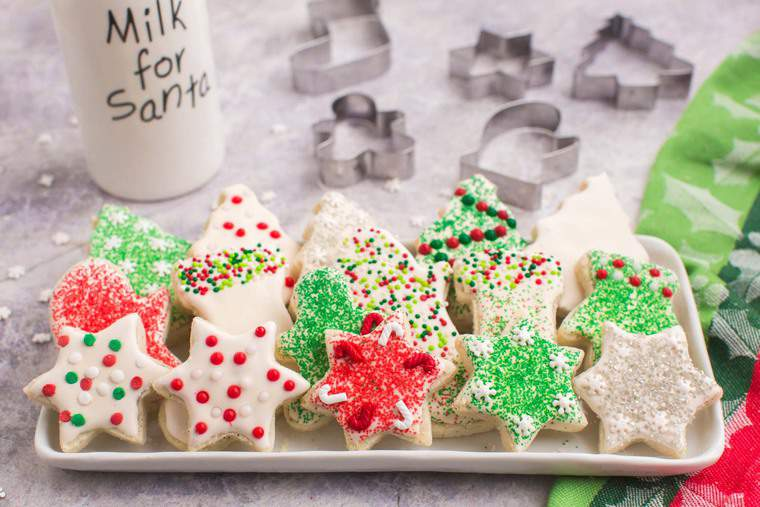 Cookies in the shapes of stars. stockings, and Christmas trees on a rectangular platter