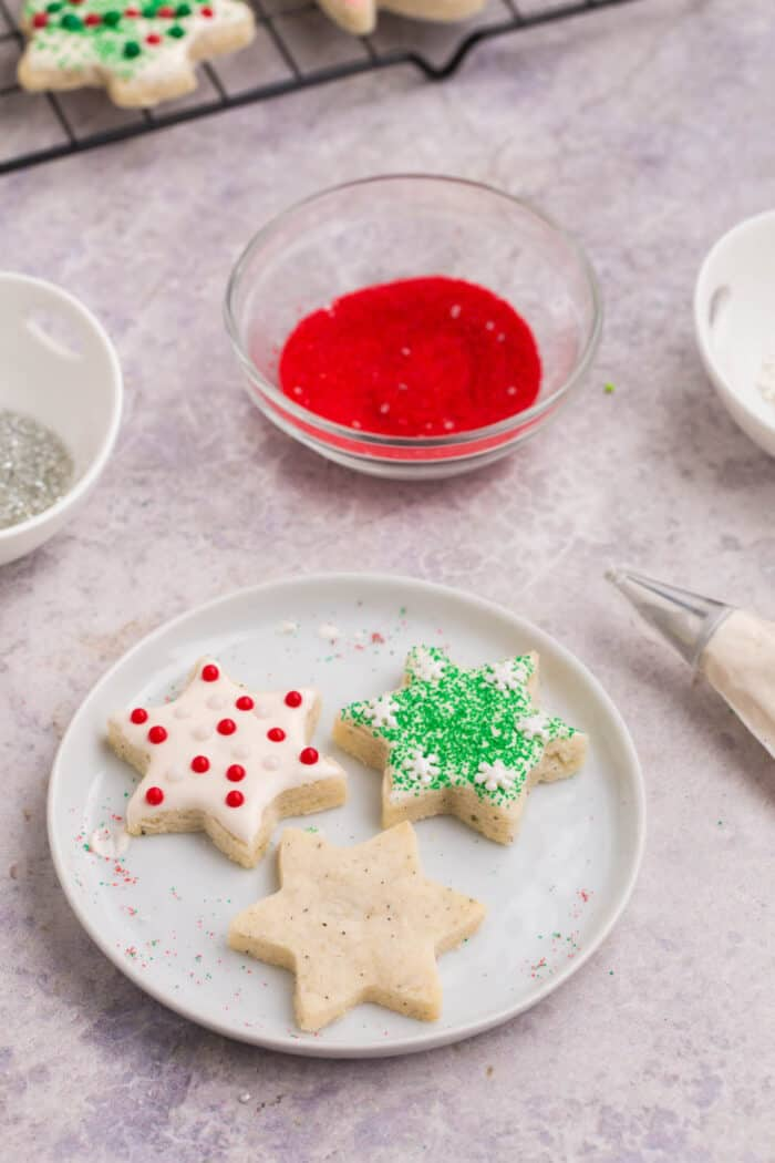 Two frosted and one unfrosted star-shaped gluten free chai cut out cookies