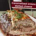 Cheese stretching from inside of a sliced stuffed meatloaf