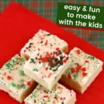 FIve stacked sugar cookie bars with frosting and holiday sprinkles