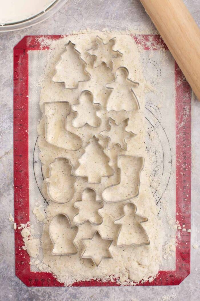 Cookie cutters laying on top of rolled out cookie dough