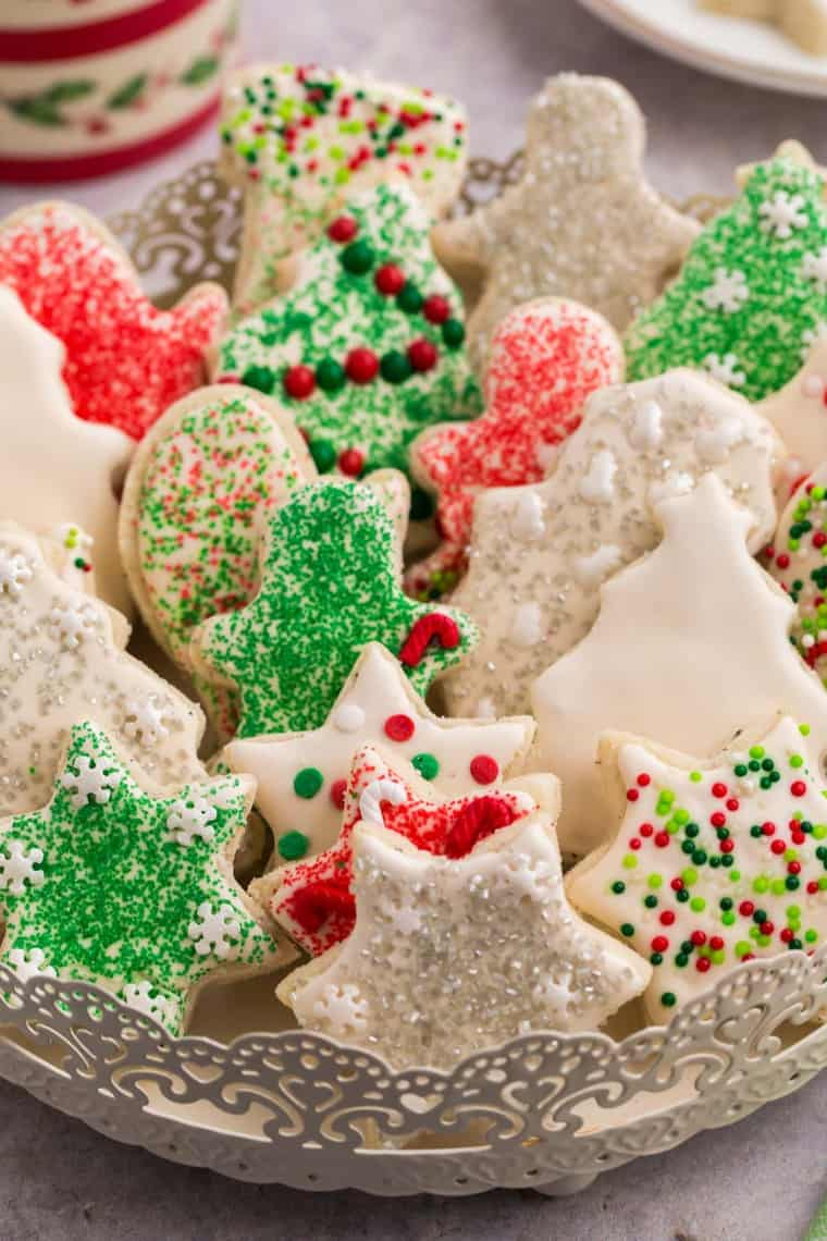 Decorated gluten free sugar cookies stacked in a decorative serving platter