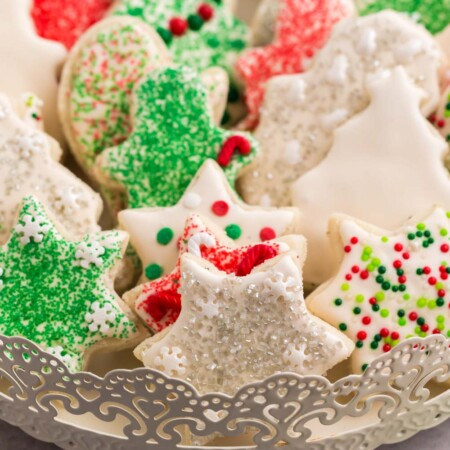 Cookies in the shapes of stars. stockings, and Christmas trees on a fancy serving tray