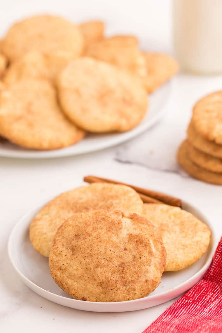 Three gluten free snickdoodles on a white plate