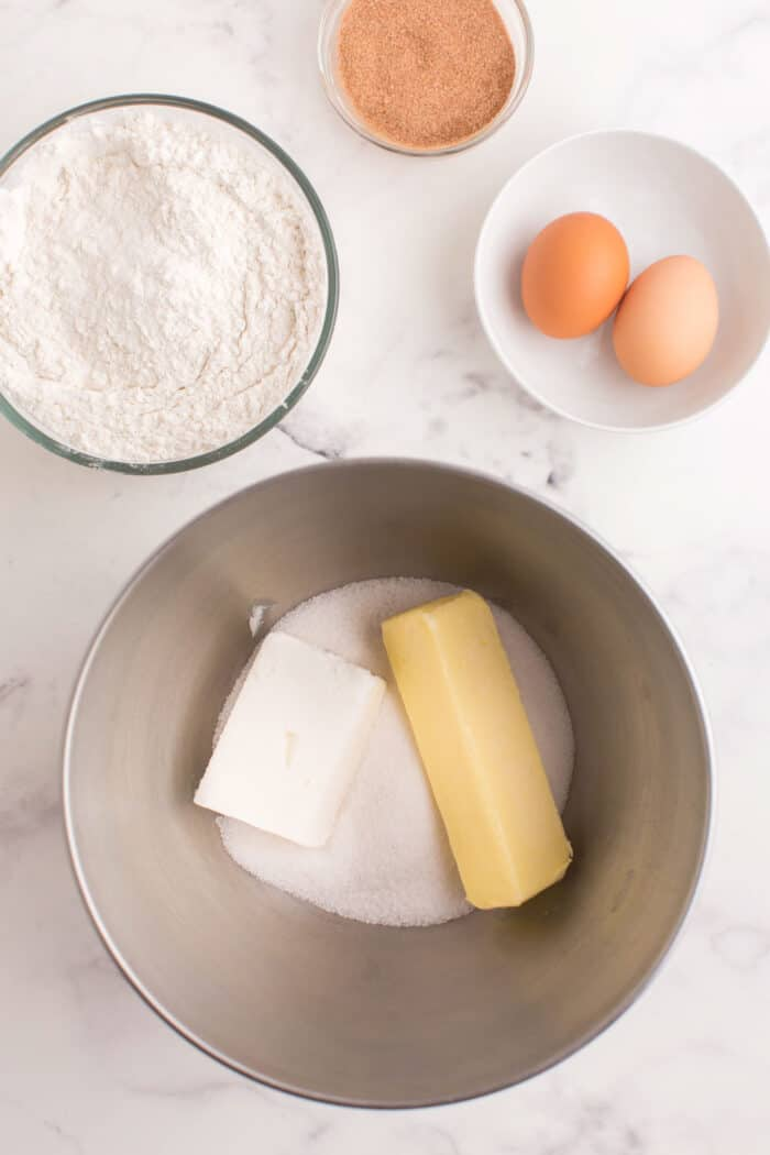 Stick of butter, shortening, and sugar in a mixing bowl