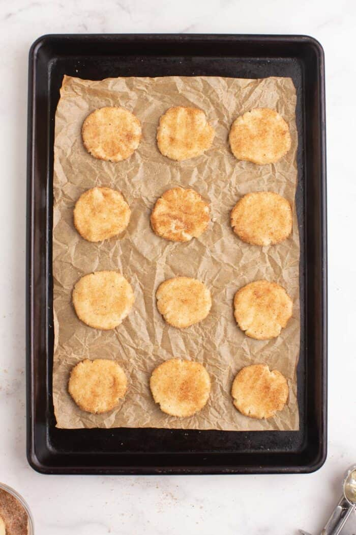 Pressed down cookie dough on a sheet pan