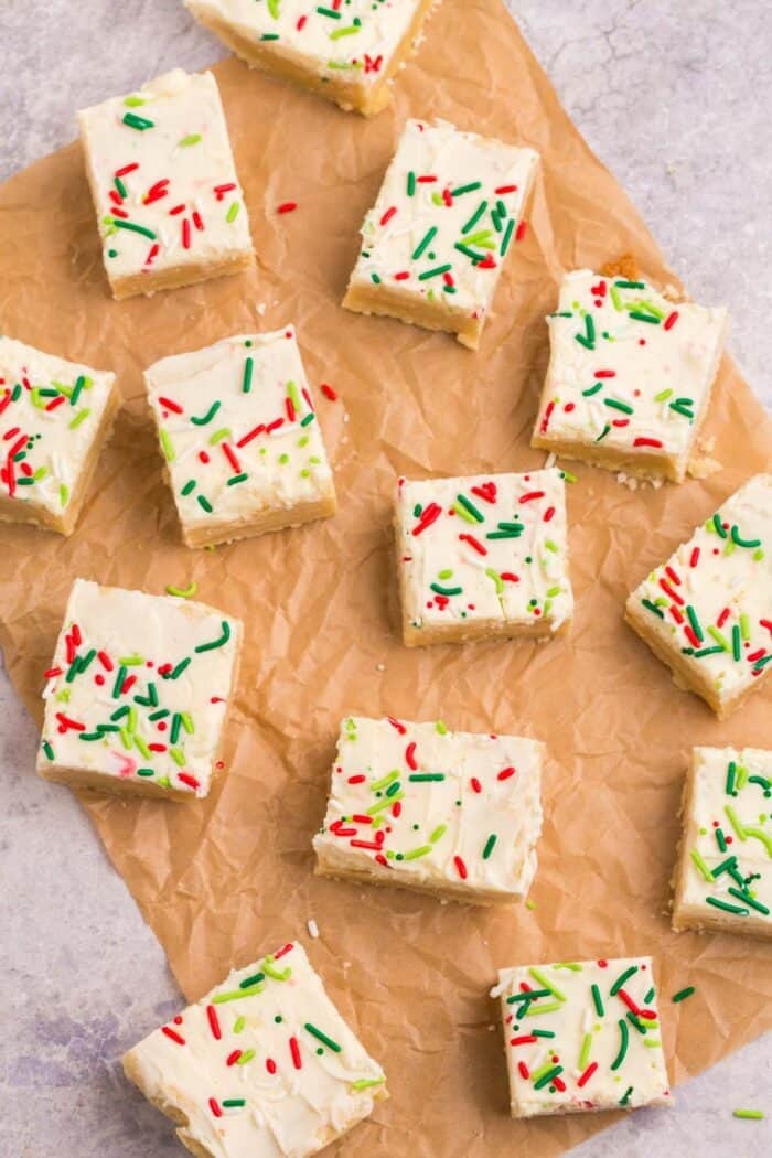 Gluten Free Sugar Cookie Bars spread out on a sheet of parchment paper