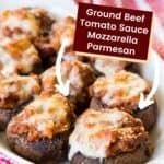Ground Beef Stuffed Mushrooms topped with mozzarella cheese in a white serving dish