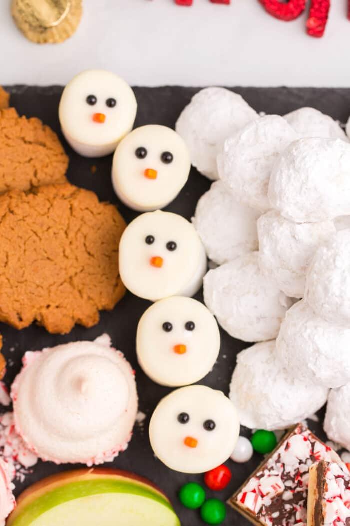 snowman marshmallows on a cookie platter