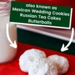 Three snowballs on a red napkin near a jelly jar filled with milk