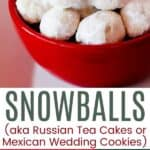 Snowball cookies in a red bowl and on a red napkin