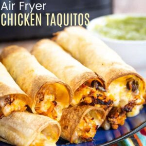 Air Fryer Chicken Taquitos in a stack on a blue plate