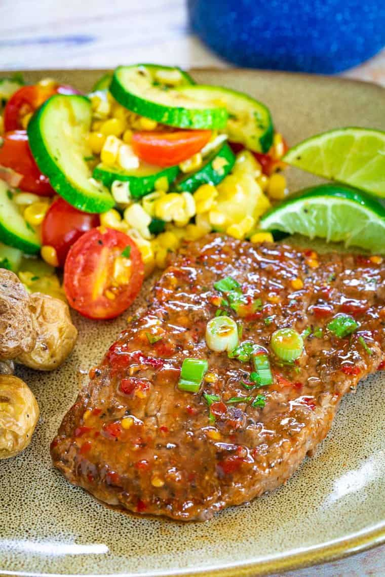 Chili Lime Cube Steaks served on a brown plate with mixed veggies
