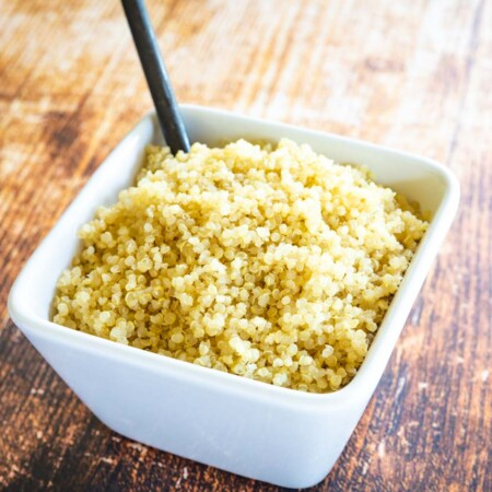 cooked quinoa in a bowl on a wooden table