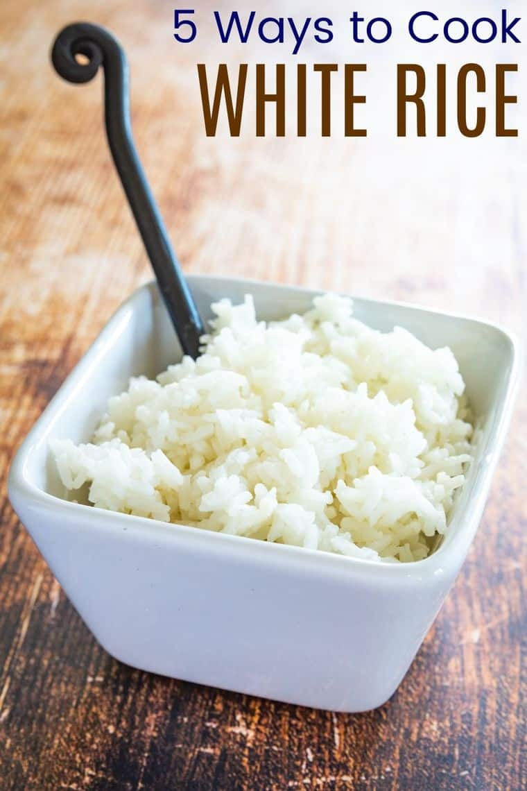 spoon in a bowl of cooked white rice