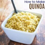 Cooked quinoa in a white square-shaped bowl