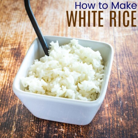 Cooked white rice in a white square-shaped bowl