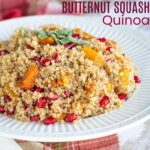 bowl of roasted butternut squash quinoa with pomegranate seeds mixed in