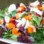 Colorful salad piled on a plate