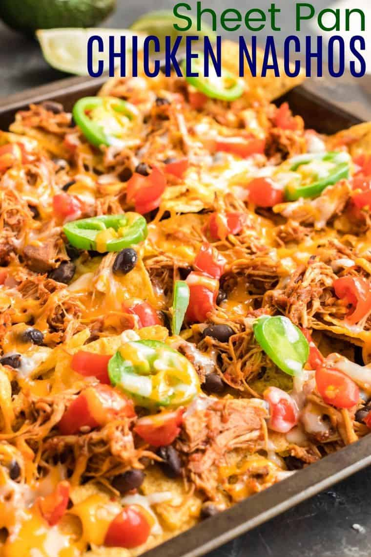 Sheet Pan Chicken Nachos covered with melted cheese