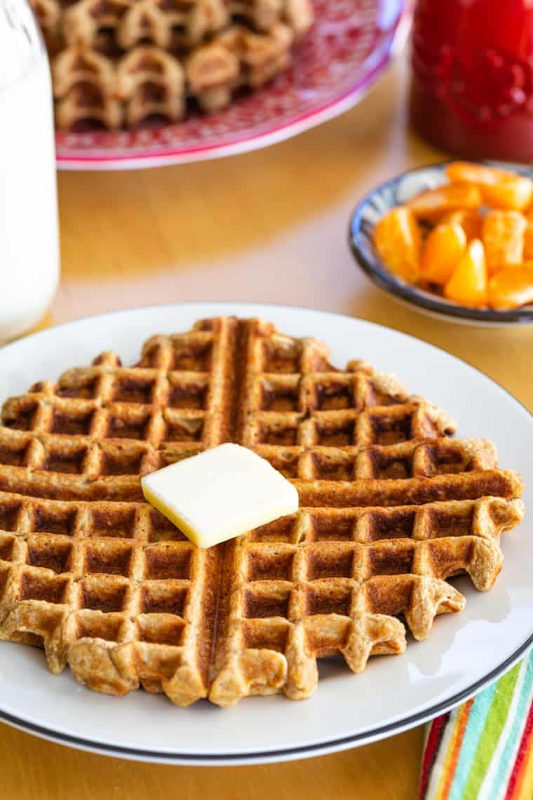 Waffle served on a table set for breakfast
