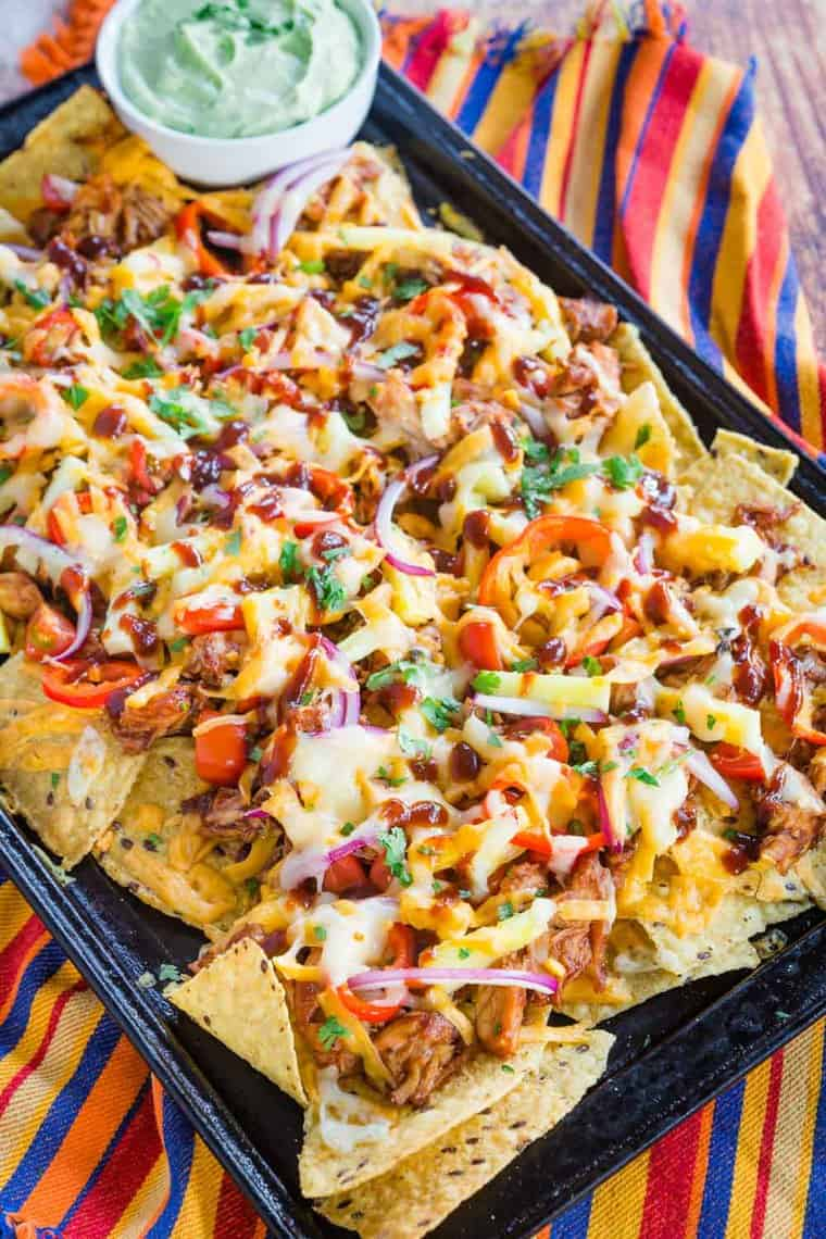 barbeque chicken nachos cooked on a baking sheet