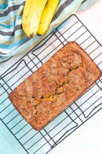 Loaf of banana bread on a cooling rack