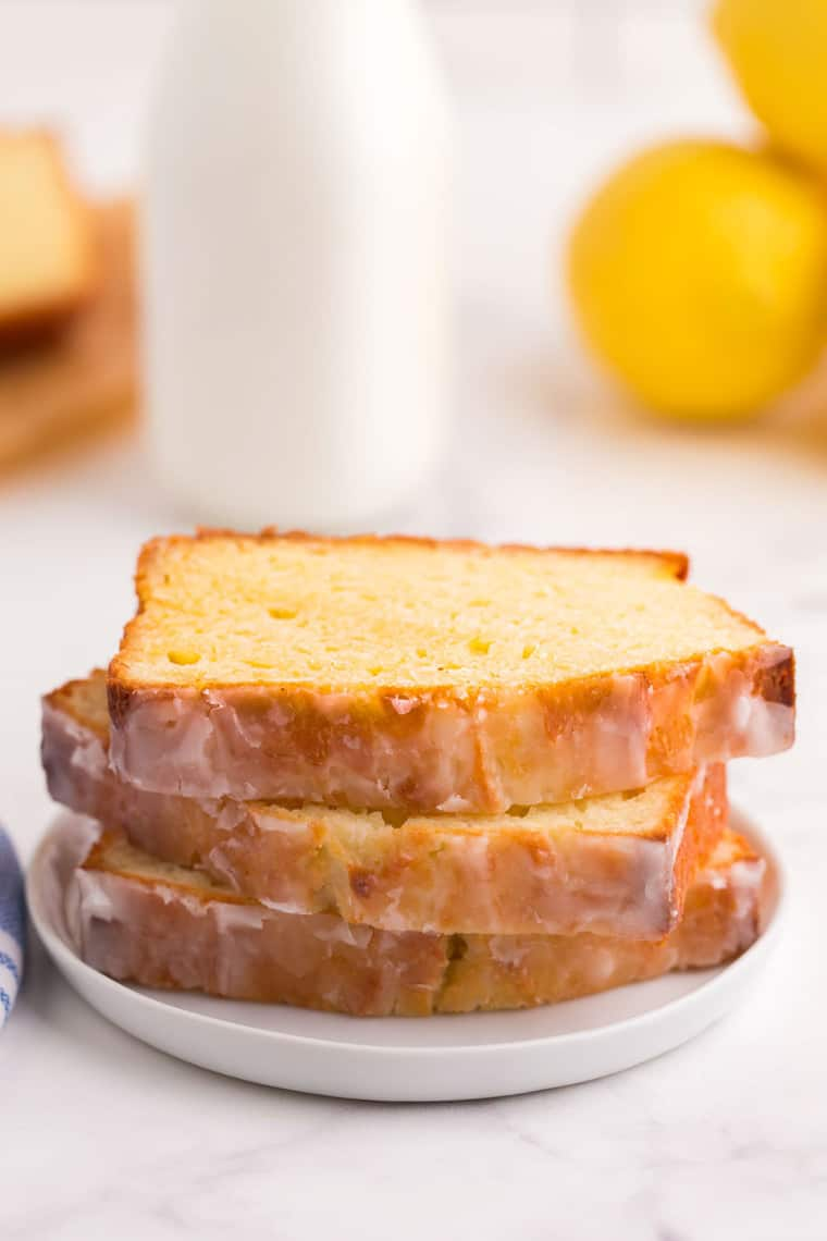 three stacked slices of the loaf on a small white plate