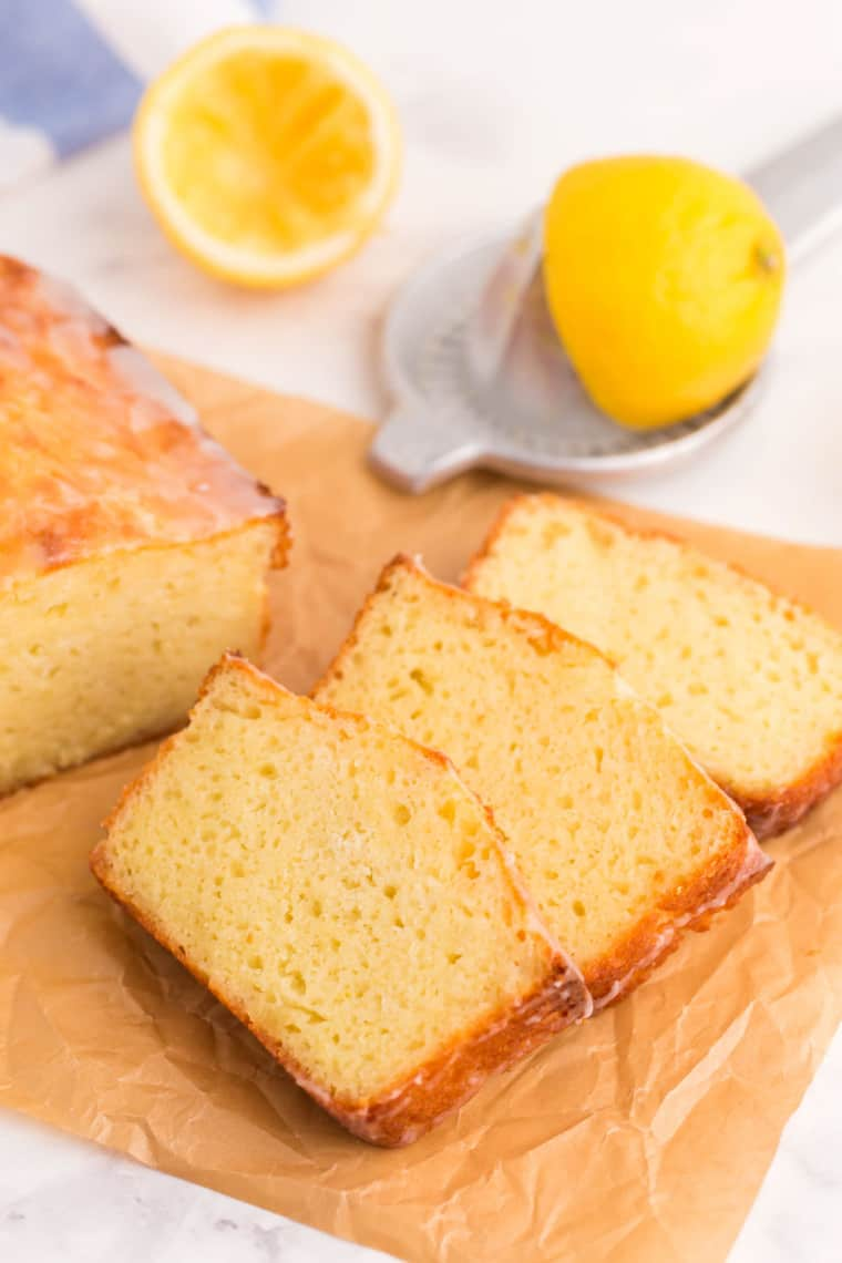 Three sliced of pound cake on a piece of parchment paper