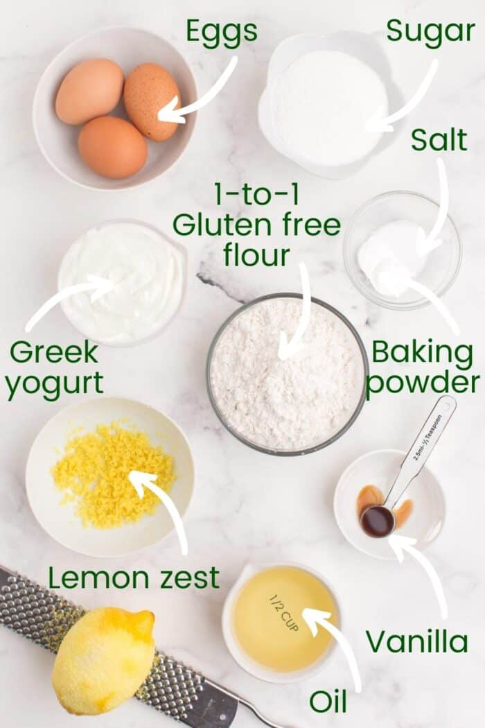 Bowls holding eggs, sugar, salt, gluten free flour, baking soda, lemon zest, vanilla, and oil
