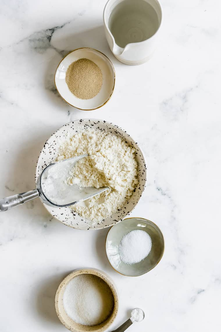Salt, Gluten-Free Flour, and the Rest of the Pizza Dough Ingredients on a Countertop