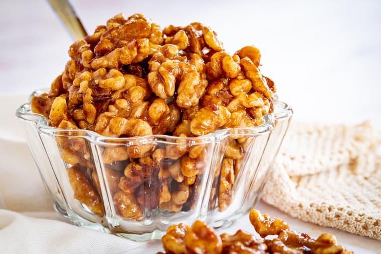 Decorative glass bowl with honey glazed walnuts